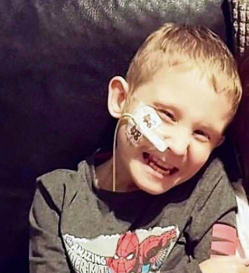 Hundreds say farewell to little superhero Lee