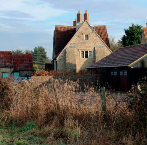 Historic buildings at Lyde Green Farm would be at the heart of the new 'village'