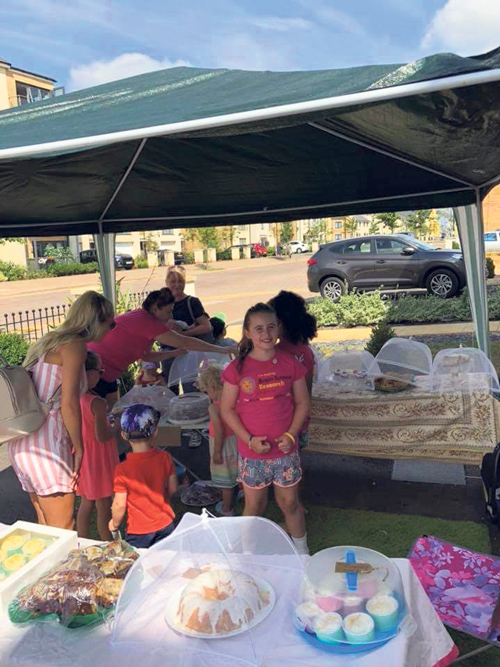 Cake sale shows Olive, 7, is a little girl with a  big heart