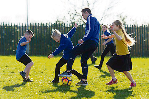 YOUNGSTERS at Barley Close Primary School enjoyed a kick-about with a Bristol Rovers player who came to visit them.